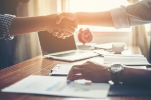 business-people-handshake-greeting-deal-at-work_1150-645